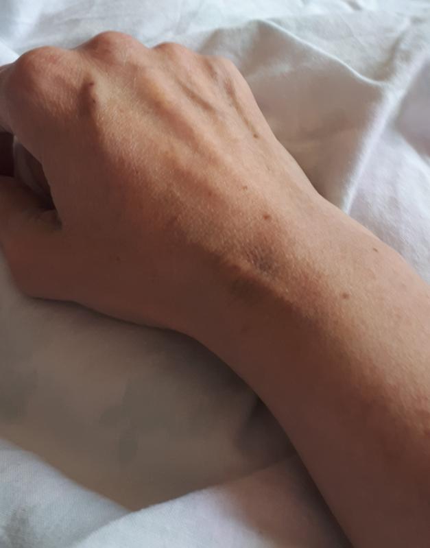 hand on white sheet